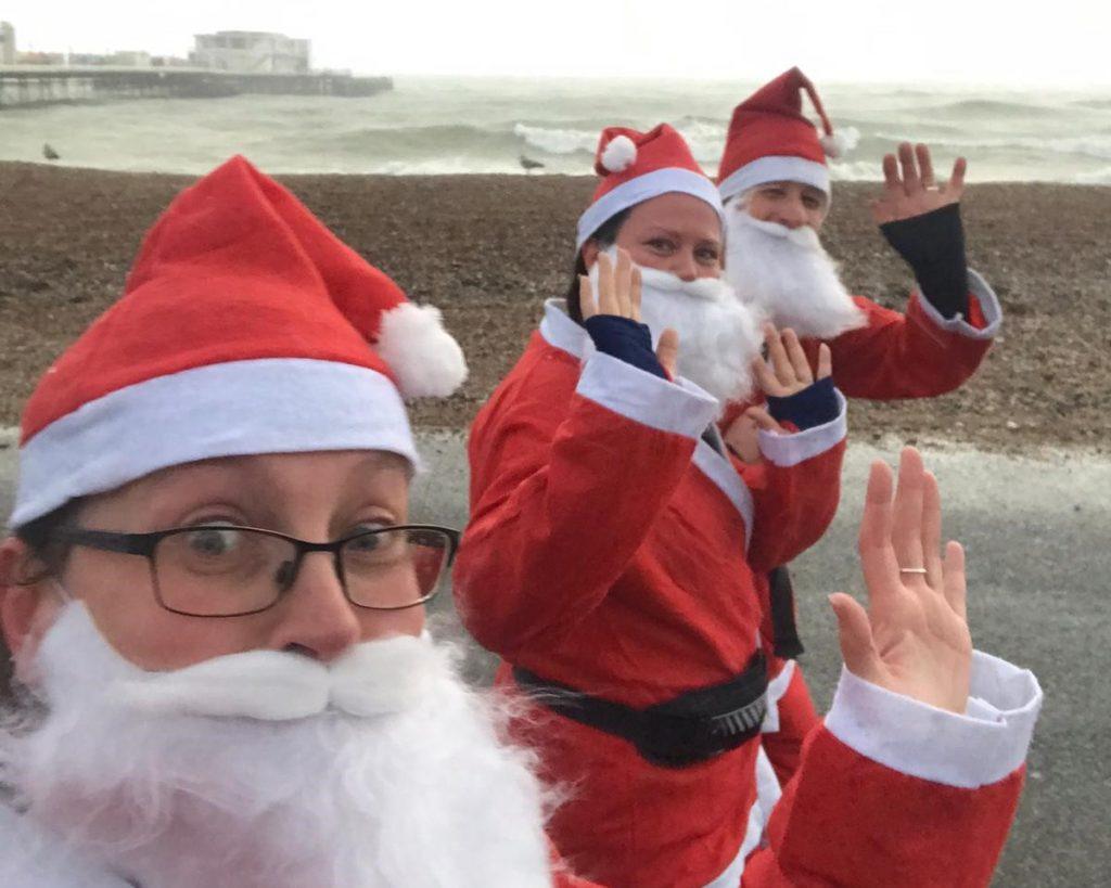 Multiple Santas seen running through Sussex