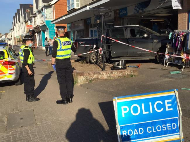 Car crashes into charity shop