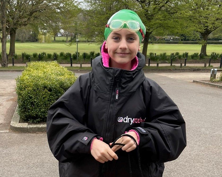 9-year-old's triathlons in memory of stillborn brother