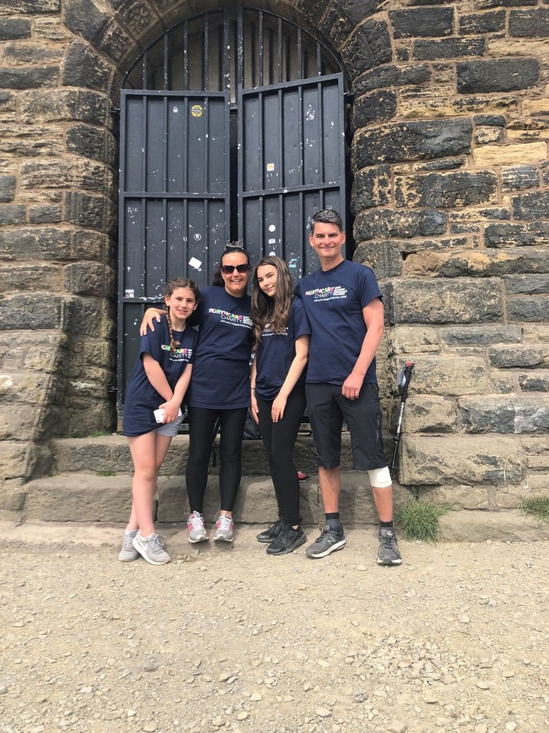 Dad left paralysed by stroke takes on charity walk