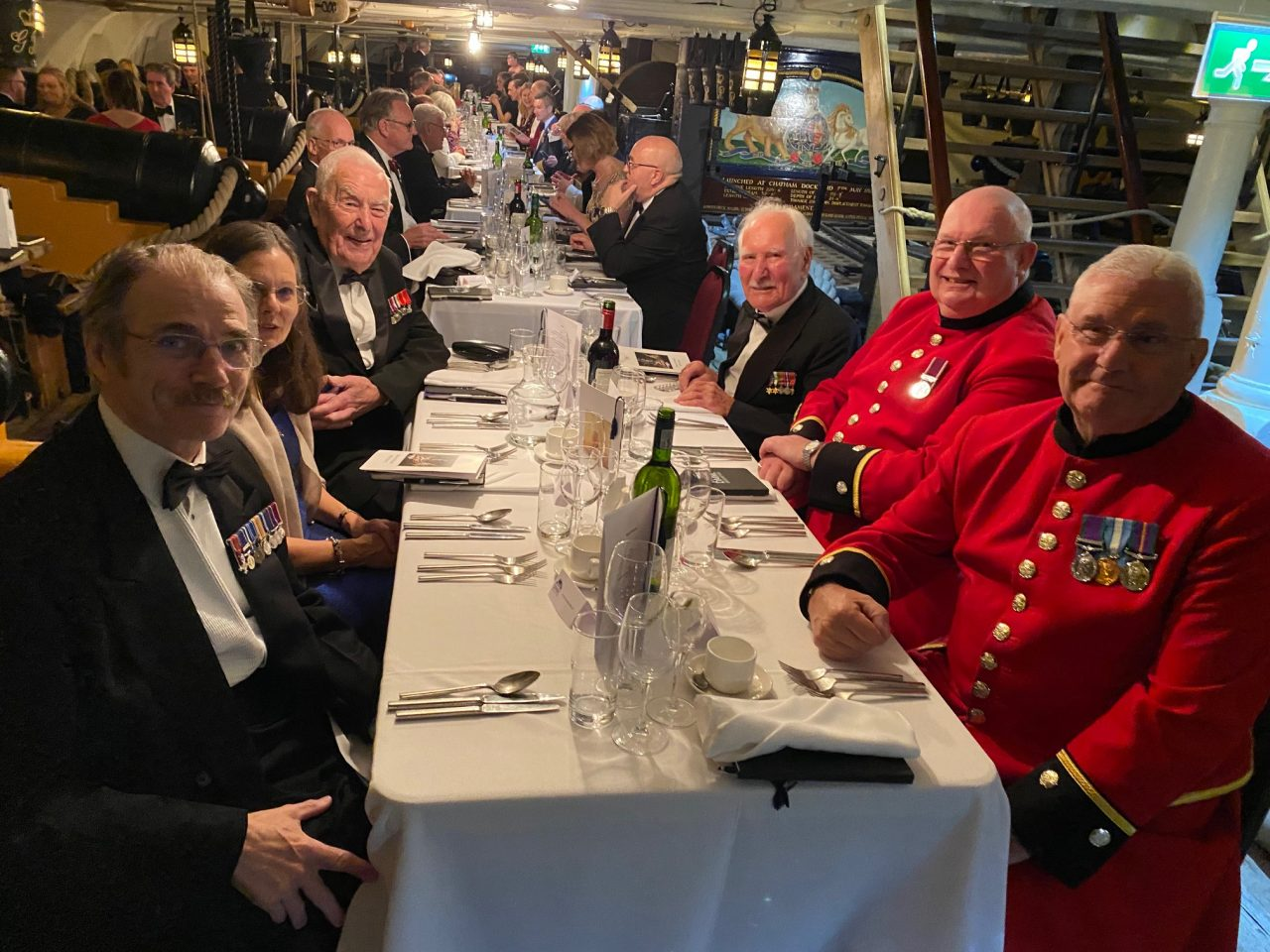 WWII Royal Navy Veterans enjoy dinner on HMS Victory